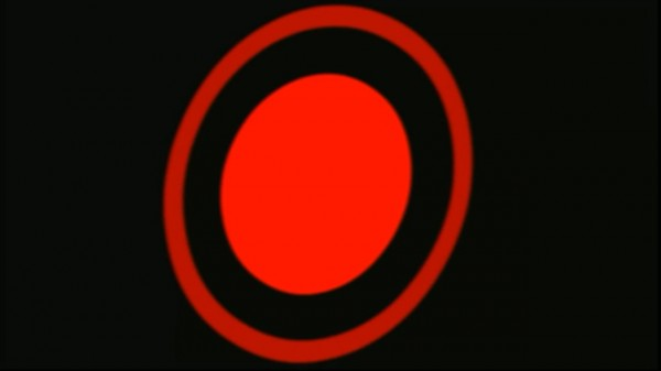 Mysterious symbol, large red dot with larger circle surrounding it on a black background